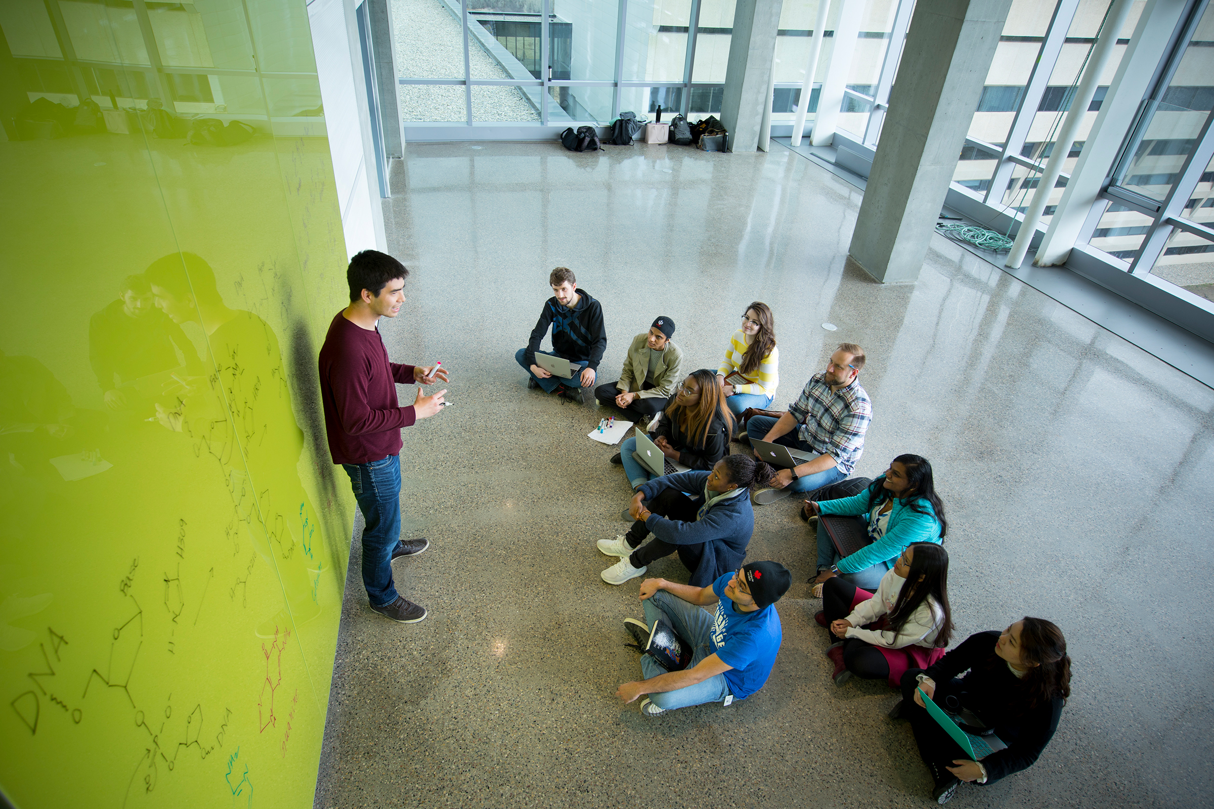Students seated in Science Commons
