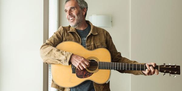 John Wort Hannam with guitar